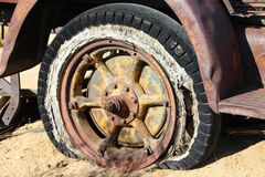 Brown Spoke Car Wheel in Brown Sand during Daytime Royalty Free Stock Photo