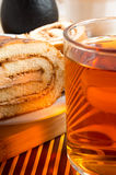 Brown sponge cake and cup of hot tea Stock Photos