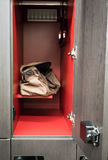 Brown sport bag sitting in men locker room with opened door show. Ing interior red finishing. Free service in fitness Royalty Free Stock Image