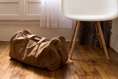 Brown Sports Bag on Parquet Floor Stock Image