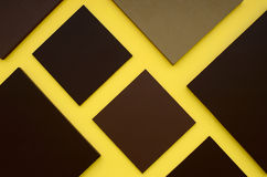 Brown square box on yellow background. For space design Stock Images