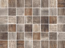 Brown wooden square mosaic tiles texture background. stock photo