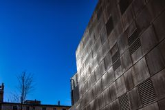 Brown squared metal facade wall on a blue sky stock photography