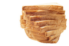 Brown stack of sliced bread on white background Stock Images