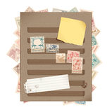 Brown stamp book page with stamps, torn paper and stock illustration
