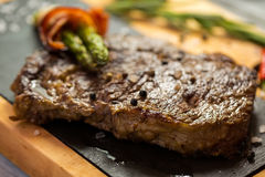 Brown steak on board. stock image