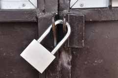 Brown steel door with padlock, Locked. Royalty Free Stock Photos