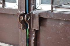 Brown steel door without padlock, unlocked. Stock Image