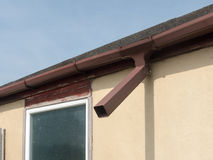 Brown steel gutter on garage Royalty Free Stock Image