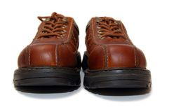 Brown steel-toe boots. Isolated on white background stock image