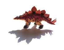 Brown stegosaurus toy with shadow. On a white background Royalty Free Stock Image