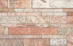Brown-Steinwand deckt Beschaffenheit mit Ziegeln Lizenzfreie Stockfotos