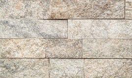 Brown-Steinwandbeschaffenheits- oder -zusammenfassungshintergrund Stockbild