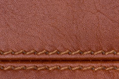 Brown stitched leather close up Stock Images