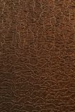 Brown stone background. Brown upholstery fabric material decorated in stone style Stock Photography