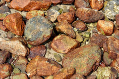 Brown stone background. Background in color and shape of various stone, shown as featured color, pattern and texture Stock Photography