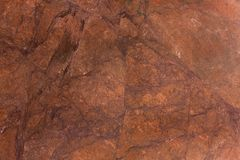 Brown stone background of mottled granite igneous rock. High resolution photo Stock Image