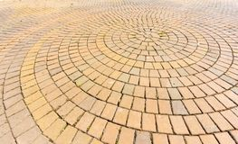 Brown stone circle paving, shot with wide angle lens Stock Photo