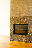 Brown stone fireplace Royalty Free Stock Photos