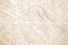 Brown stone floor tile seamless background Stock Photos