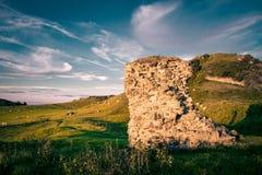 Brown Stone Formation Near the Mountain Stock Photos