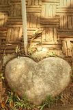 Brown stone of heart in a garden. Royalty Free Stock Images