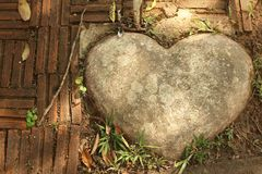 Brown stone of heart in a garden. Stock Photography
