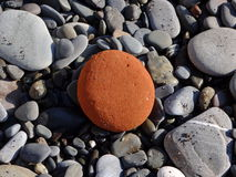 Brown stone among stones Royalty Free Stock Images