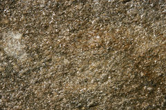 Brown stone texture wall Royalty Free Stock Photos