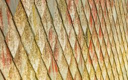 Stone roof pattern background. Brown stone tiles roof texture architecture background seamless pattern, detail of house close up Stock Photos