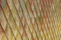 Stone roof pattern background. Brown stone tiles roof texture architecture background seamless pattern, detail of house close up Royalty Free Stock Photography