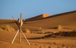 Brown Stone on Tripod Sticks at a Desert royalty free stock photography