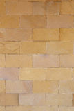Brown stone wall for background design. Royalty Free Stock Photos