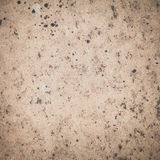 Brown stone wall tile seamless background Stock Images