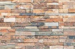 Brown stone wall tiles texture. Royalty Free Stock Photos