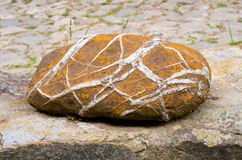 Brown stone with white lines Stock Photo