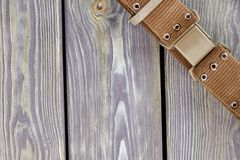 Brown strap on grey wood. royalty free stock photo