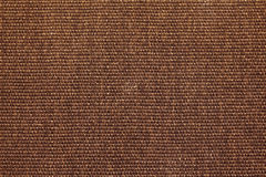 Brown straw carpet macro. Background texture Royalty Free Stock Images
