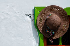 Brown straw hat hanging on colorful doorway Royalty Free Stock Photography