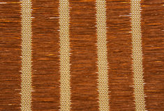 Brown straw mat texture with vertical patterns. Royalty Free Stock Photos