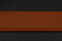 Brown stripe on black background. Belt from skin or leather. Belt in brown color Royalty Free Stock Photos
