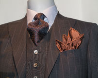 Brown Striped Jacket, Tie, Tan Handkerchief. Close up of a dark brown striped jacked with patterned black & red tie and tan handkerchief stock photography