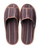 Brown striped slippers isolated on white background. Close up, high resolution Stock Images