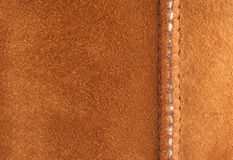 Brown suede background with seam Stock Photo