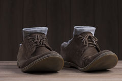 Brown suede shoes with brown laces and grey socks Royalty Free Stock Photography