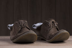 Brown suede shoes with brown laces and grey socks Royalty Free Stock Photo