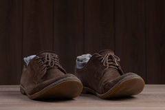 Brown suede shoes with brown laces and grey socks Royalty Free Stock Images