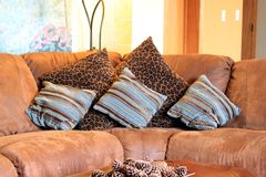Brown suede sofa couch with pillows Stock Photo