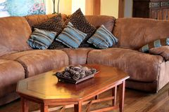 Brown suede sofa couch with pillows Royalty Free Stock Images