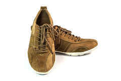 Brown suede sports shoes Stock Images